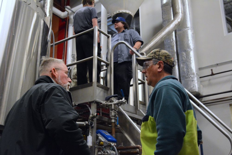 Up on the brewhouse platform, brewer Dean Lake and son Schuyler Lake represented Dog…